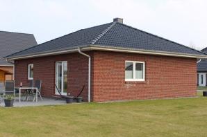 Schlüsselfertiges Singlehaus mit rotem Backstein im Holzrahmenbau